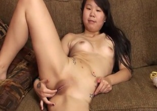 Masturbating amateur Asian with X-rated tattoos
