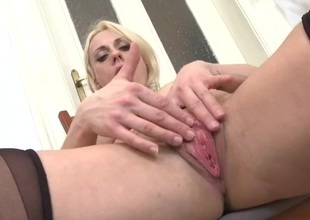 Masturbating blonde milf licks their like one another fingers whisk