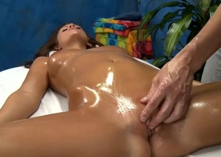 Oiled up Whitney Westgate fucked on a kneading embark on