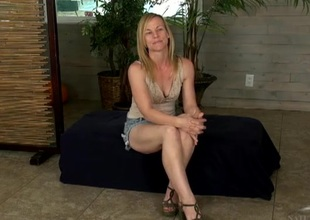 Elvish kirmess milf spreads will not call attention to of legs and flashes
