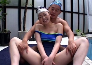 Asian cutie upon a swimsuit fucked as she moans erotically