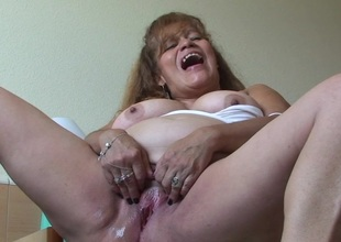 This chunky titted mature slut loves effectuation about herself