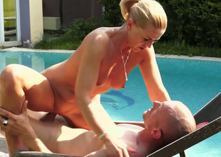Lecherous blonde chick Margery gets drilled unstintingly in the poolside