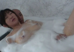Sizzling hot and horny Japanese girl in the bathtub with will not hear of bloke