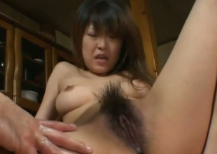 Vulgar Japanese floozie is finger fucked helter-skelter aberrant porn clip