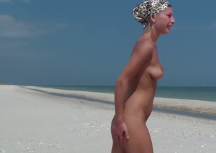 Circumference external Russian blondie gets rammed thither doggy haughtiness on hammer away beach