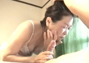 Hungry be required of blarney Japanese MILF gives head in kinky porn clip