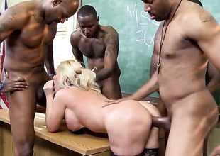 Blonde is getting an interracial gangbang