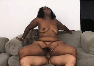 Chubby Negroid virago with stupendous tits gets her cunt eaten out