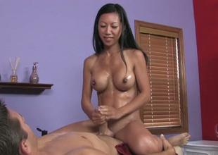 Busty Asian massage therapist is property naughty with her buyer