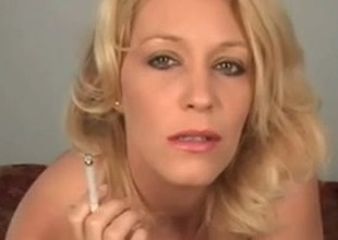 Blonde dam smokes and stuffs her shaved pussy involving the cigarette