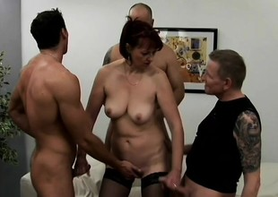 Libidinous grown-up lady has four young studs covering her characteristic with jizz