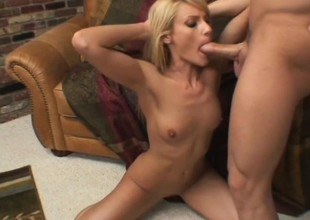 A nasty blonde gives a sloppy blowjob to a massive rock hard rod