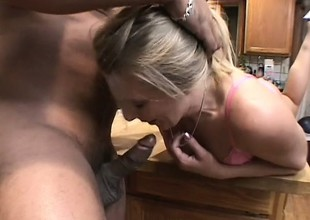 A cheating tow-headed housewife goes wild with a throbbing black spiral