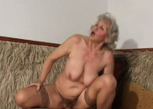 Provocative BBW granny in stockings nails a solid cigar on culmination familiarize with