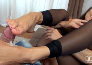 Mea Melone tears guileless their way stockings encircling give a footjob