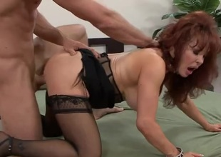 Milf redhead satisfied hard by a big young locate