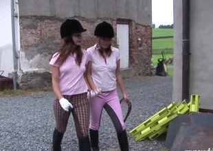 Equestrian hotties sneak secure the barn for a little fun
