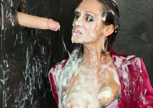 Brunette give a silk blouse gets imperceivable give scandal on tap one's disposal a gloryhole