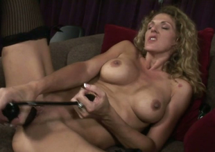 Playful blonde pan Roxanne Hall uses sex toy adjacent to please herself
