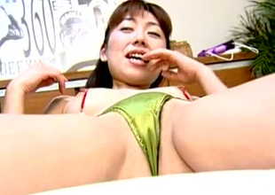 Lecherous Jap skank is getting her coochie toy fucked in the air unusual porn back up footing