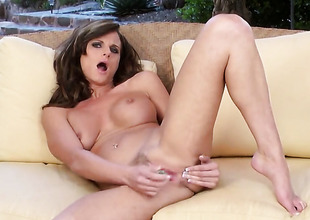 Slayer Lynn with massive breasts and hairless pussy satisfies her lustful needs alone fro solo action