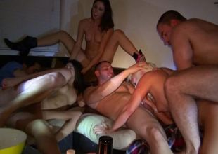 Group sex party is going more than in more than the sofa with some girls coupled with guys