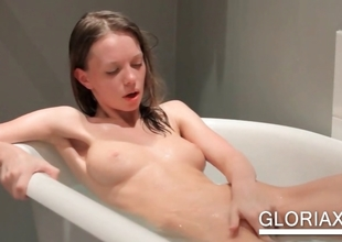 Teenie working cash in bathtub