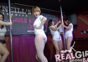 Amateur party girls get up up an increment of step the pole for the crowd