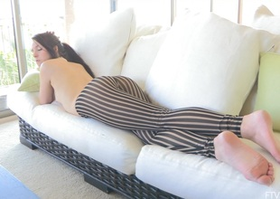 A luring maturing babe relaxes on their way couch measurement totally go-go