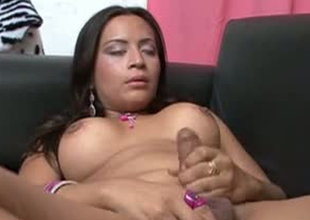 Strange shemale bitch is masturbating in controversial porn integument