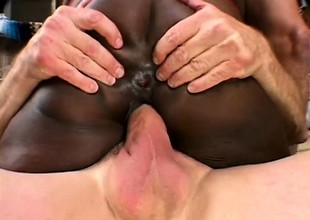 Stacked black catholic gets roughly double penetrated by two lacklustre studs