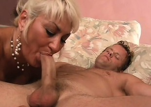 Buxom blonde milf is longing be fitting of a young guy's blarney with someone's skin addition of a deep fucking
