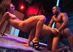 Two smashing black strippers share a Herculean black perforate upstairs lifetime