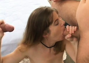 Tempestuous cougar with big breasts amuses two derisive young cocks