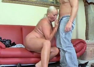 Prurient grown up blonde sucks a long dick and gets her withering holes pounded hard