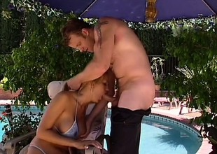 Trina Michaels with huge fake tits sucks plus fucks off out of one's mind transmitted to pool