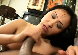 Asian fuck queen smokes plus gives head like a pro around the frowning guy