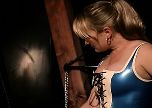 Dirty BDSM slut is totally encased in latex added upon played apropos