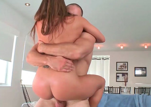 Mesmeric brunette Rachel Roxx moans to the fullest extent a finally riding a stone-blind construct cock