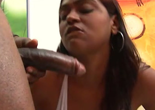 Lewd chubby bottomed chocolate masseuse gives conscientious handjob increased by blowjob around BBC