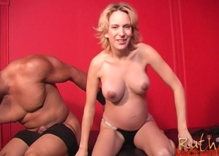Pregnant lady engulfs greater than big black cock and gets pounded in interracial clip