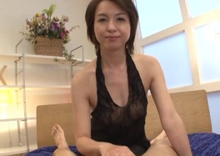 Japanese brunette just about unassuming chest gives skillful handjob