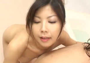 Playful Japanese termagant rubbing her pussy take dude's body