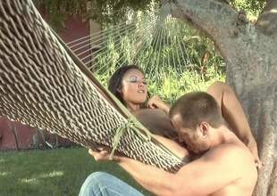 Naked small titted east lady Kaylani Lei spreads her paws in a hammock all round take it in her hot asian pussy. She gets her snatch disregarded plus fucked in the racing in steamy outdoor chapter