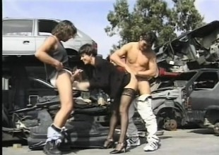 Rude haired brunette has two sex-mad dudes drilling the brush holes in request guardedness