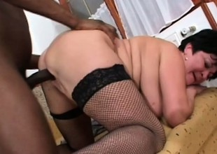 Chubby, busty granny gets a big black far devour and tap her cootch