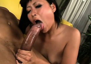 Japanese cutie in stockings chokes more a big black cock and rides it