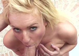 A blonde is displaying her large bosom beside the bathroom in the long run b for a long time sucking