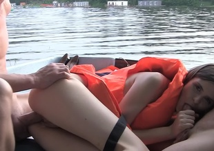 Hardcore on a boat with a cutie in a life vest